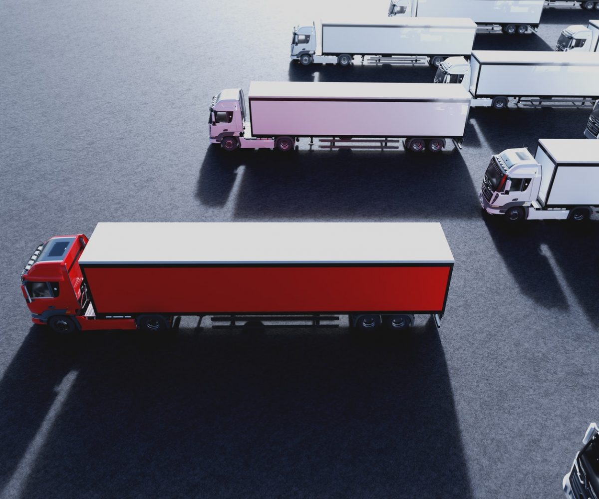 Fleet of new heavy trucks with one selected. Transportation